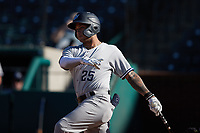 Everson Pereira (25) of the Hudson Valley Renegades follows through on his swing against the Greensboro Grasshoppers at First National Bank Field on September 2, 2021 in Greensboro, North Carolina. (Brian Westerholt/Four Seam Images)