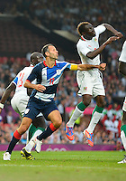 July 26, 2012..Britain's Ryan Giggs (11) and Senegal's Saliou Ciss (2). Great Britain vs Senegal Football match during 2012 Olympic Games at Old Trafford in Manchester, England. Senegal held Great Britain to a 1-1 draw...(Credit Image: © Mo Khursheed/TFV Media)