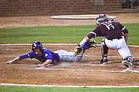 LSU Tigers outfielder Andrew Stevenson (6) slides head-first across home plate avoiding the tag by Texas A&M Aggies catcher Troy Stein (6) in the NCAA Southeastern Conference baseball game on May 10, 2013 at Blue Bell Park in College Station, Texas. LSU defeated Texas A&M 7-4. (Andrew Woolley/Four Seam Images).