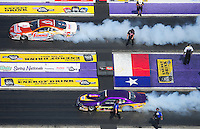 Apr. 28, 2012; Baytown, TX, USA: Aerial view of NHRA pro stock driver Jason Line (top) burns out alongside Vincent Nobile during qualifying for the Spring Nationals at Royal Purple Raceway. Mandatory Credit: Mark J. Rebilas-