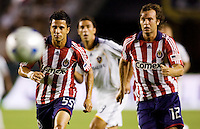 Chivas USA players Marcelo Saragosa (l) and Carey Talley (r) chase a ball loose ball. The LA Galaxy defeated Chivas USA 1-0 to win the final edition of the 2009 SuperClásico at Home Depot Center stadium in Carson, California on Saturday, August 29, 2009...