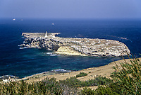 St. Paul's Island, Malta.  In the fall of 60 AD Saint Paul was shipwrecked in the bay currently bearing his name.  Tradition says he landed on this small island in the bay.  A statue to his honor was erected in 1845.