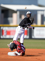 Olympia Titans shortstop Nick Gordon (5) attempting to turn a double play as Forrest Wall (31) slides in during a game against the Orangewood Christian Rams at Olympia High School on February 19, 2014 in Olympia, Florida.  (Mike Janes/Four Seam Images)