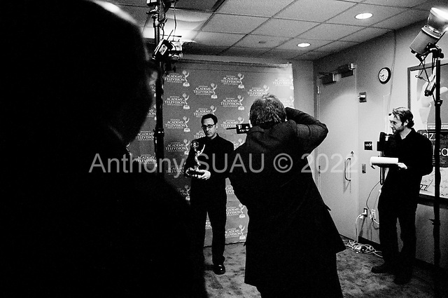 New York, New York<br /> USA<br /> September 27, 2010<br /> <br /> The 31st Annual News and Documentary, Emmy Awards held at Frederick P. Rose Hall, Jazz at Lincoln Center.<br /> <br /> Back stage with the winners as they have their photo made and meet the press. The New York Times team poses for a picture after winning an  Emmy for New Approaches to News and Documentary Programming Documentaries for a series entitled, One in Eight Million.