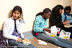Education high school students studying and socializing in corridor during lunch break