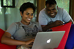 Fishing Cat (Prionailurus viverrinus) biologists, Anya Ratnayaka and Maduranga Ranaweera, reviewing camera trap images, Urban Fishing Cat Project, Sigiriya, Sri Lanka