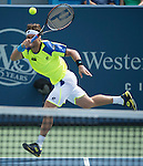 David Ferrer (ESP), defeats Ryan Harrison, (USA) 7-6, 3-6, 6-4 at the Western & Southern Open in Mason, OH on August 13, 2013.