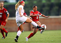 WINSTON-SALEM, NORTH CAROLINA - September 01, 2013:<br />  Charlyn Corral (9) of Louisville University goes for the ball with Caralee Keppler (20) of Wake Forest University during a match at the Wake Forest Invitational tournament at Wake Forest University on September 01. The match was abandoned early in the second half due to severe weather with Wake leading 1-0.