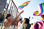 A child with the Gay Pride flah during the protest Madrid Pride 2016. July 02. 2016. (ALTERPHOTOS/Borja B.Hojas)