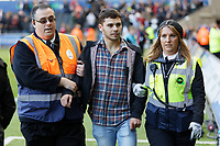 A pitch invader is removed off the pitch during the Sky Bet Championship match between Swansea City and Cardiff City at the Liberty Stadium, Swansea, Wales, UK. Sunday 27 October 2019