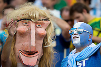 A puppet head and a blue painted Argentina fan