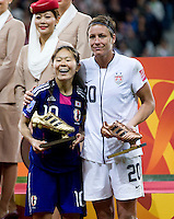 Abby Wambach, Homare Sawa.  Japan won the FIFA Women's World Cup on penalty kicks after tying the United States, 2-2, in extra time at FIFA Women's World Cup Stadium in Frankfurt Germany.