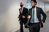 United States Senator Rick Scott (Republican of Florida), left, and a staff member and other Senators evacuate to a safe place in the Dirksen Senate Office Building after Electoral votes being counted during a joint session of the United States Congress to certify the results of the 2020 presidential election in the US House of Representatives Chamber in the US Capitol in Washington, DC on Wednesday, January 6, 2021, as interrupted as thousands of pr-Trump protestors stormed the U.S. Capitol and the House chambers.  .<br /> Credit: Rod Lamkey / CNP/AdMedia