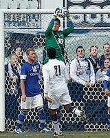 Creighton University goalkeeper Jeff Gal (30) collects a cross..NCAA Tournament. Creighton University (blue) defeated University of Connecticut (white), 1-0, at Morrone Stadium at University of Connecticut on December 2, 2012.