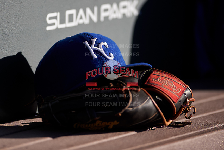 An AZL Royals hat rests on a Rawlings baseball glove during an Arizona League game against the AZL Cubs 1 on June 30, 2019 at Sloan Park in Mesa, Arizona. AZL Royals defeated the AZL Cubs 1 9-5. (Zachary Lucy/Four Seam Images)