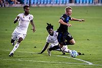 SAN JOSE, CA - SEPTEMBER 05: Jackson Yueill #14 is tackled by Lalas Abubakar #6 during a game between Colorado Rapids and San Jose Earthquakes at Earthquakes Stadium on September 05, 2020 in San Jose, California.
