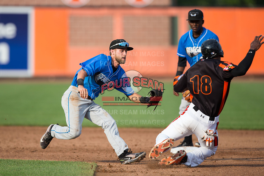 Hudson Valley Renegades shortstop Deion Tansel (9) applies a tag to Jaylen Ferguson (18) of the Aberdeen IronBirds as he slides into second base at Leidos Field at Ripken Stadium on July 27, 2017 in Aberdeen, Maryland.  The Renegades defeated the IronBirds 2-0 in game one of a double-header.  (Brian Westerholt/Four Seam Images)