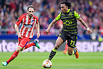 Gelson Martins of Sporting CP (R) fights for the ball with Juan Francisco Torres Belen, Juanfran, of Atletico de Madrid (L) during the UEFA Europa League quarter final leg one match between Atletico Madrid and Sporting CP at Wanda Metropolitano on April 5, 2018 in Madrid, Spain. Photo by Diego Souto / Power Sport Images