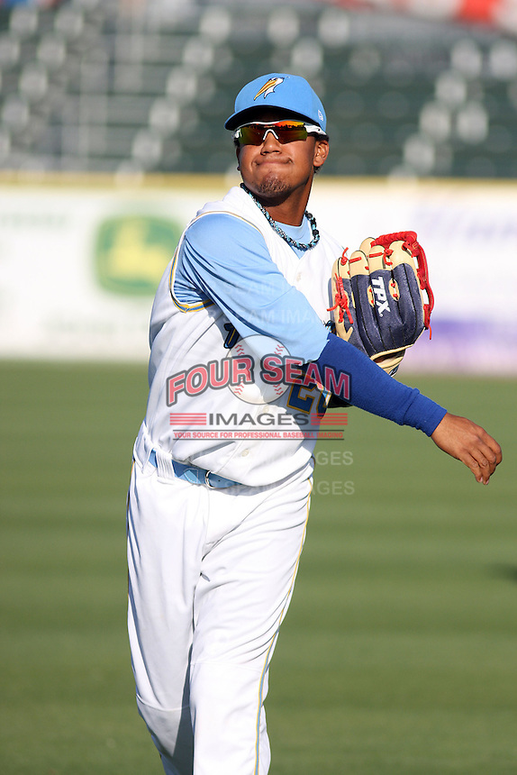 Myrtle Beach Pelicans outfielder Teodoro Martinez #20 throwing before a game against the Wilmington Blue Rocks at Tickerreturn.com Field at Pelicans Ballpark on April 8, 2012 in Myrtle Beach, South Carolina. Wilmington defeated Myrtle Beach by the score of 3-2. (Robert Gurganus/Four Seam Images)