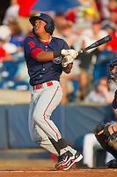 Reynaldo Rodriguez #47 of the Greenville Drive follows through on his swing against the Rome Braves at State Mutual Stadium July 24, 2010, in Rome, Georgia.  Photo by Brian Westerholt / Four Seam Images