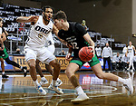 SIOUX FALLS, SD - MARCH 7: Filip Rebraca #12 of the North Dakota Fighting Hawks drives to the basket against Kevin Obanor #0 of the Oral Roberts Golden Eagles during the Summit League Basketball Tournament at the Sanford Pentagon in Sioux Falls, SD. (Photo by Dave Eggen/Inertia)