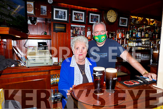 John C O'Shea  with his mother Joan behind the counter of  Jack C's pub Killarney on Monday after reopening