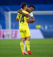 25th September 2021; Estadio Santiagp Bernabeu, Madrid, Spain; Men's La Liga, Real Madrid CF versus Villarreal CF; Militao of Real Madrid embraces Manu Trigueros of Villarreal