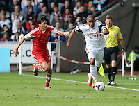 Saturday, 03 May 2014<br /> Pictured L-R: Jack Cork of Southampton chasing Ashley Williams of Swansea. <br /> Re: Barclay's Premier League, Swansea City FC v Southampton at the Liberty Stadium, south Wales.