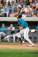 Grand Rapids Dam Breakers Gage Workman (27) bats during a game against the Fort Wayne TinCaps on August 21, 2021 at LMCU Ballpark in Comstock Park, Michigan.  The West Michigan Whitecaps rebranded for the day as the Grand Rapids Dam Breakers to bring awareness to the Grand River Restoration Project. (Mike Janes/Four Seam Images)