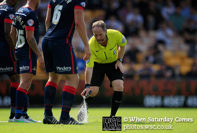Port Vale 3 Doncaster Rovers 0, 22/08/2015. League One, Vale Park. Referee Robert Lewis marks the position of the Doncaster wall with vanishing spray. Photo by Paul Thompson.