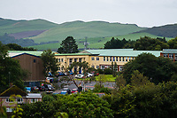 "COPY BY TOM BEDFORD<br /> Pictured: Ysgol Penglais School in Aberystwyth, Wales, UK<br /> Re: More than 400 pupils at a comprehensive school in Aberystwyth were given detention on their first day back for breaking school uniform rules.<br /> The uniform was changed at Ysgol Penglais over the summer, following a consultation.<br /> But a number of parents have complained to the school and some 250 have signed a petition saying the punished pupils were ""treated unfairly"".<br /> Ceredigion council said a large number of pupils were kept in at break times.<br /> The new uniform was brought in for the start of the new academic year, with the old navy blue pullover and white polo shirt replaced by a grey v-neck jumper, white shirt and a tie. Sixth formers have a similar outfit.<br /> It is compulsory for all pupils in years 7 and 12 to wear the new uniform, with other students being given the rest of the year to buy it.<br /> This was outlined in correspondence sent to all parents over the summer months, which also stipulated what trousers, skirts and shoes would be deemed acceptable.<br /> But the petition said the new rules were not clear enough and that the pupils should not have been punished for their parents' mistakes.<br /> It also said a warning should have been given before the detention."