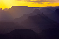 South rim view of a yellow sunset over Grand Canyon in Arizona, USA