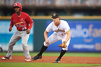 Bradenton Marauders first baseman Jerrick Suiter (25) holds on Juan Herrera (27) leading off during a game against the Palm Beach Cardinals on August 9, 2016 at McKechnie Field in Bradenton, Florida.  Palm Beach defeated Bradenton 8-7.  (Mike Janes/Four Seam Images)