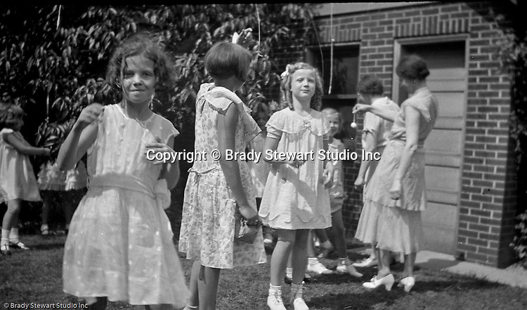 Wilkinsburg PA:  View of Sally Stewart's 7th birthday party in the backyard of the Stewart's Wilkinsburg home. Eat the Marshmallow birthday game was made famous by the girl scouts during this time.