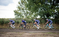 Mathieu van der Poel (NED/Alpecin-Fenix) led by hi steammates (and a stranger) over the gravel<br /> <br /> Antwerp Port Epic / Sels Trophy 2021 (BEL)<br /> One day race from Antwerp to Antwerp (183km)<br /> <br /> The APC stands qualified as a 'road race', but with 36km of gravel and 28km of cobbled sections in and around the Port of Antwerp (BEL) this race occupies a unique spot in the Belgian race scene.<br /> <br /> ©kramon