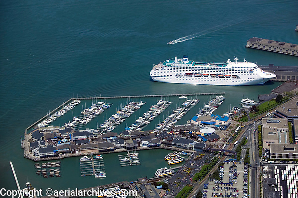 aerial photograph of Fisherman's Wharf and Pier 39, San Francisco, California; a cruise ship is docked in the background