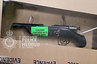 Pictured: One of the sawn-off shot-guns recovered by police.<br /> Re: Craig Agius and Sarah Pope, who dumped sawn-off shotguns and live ammunition in a bin at a Tesco supermarket, have been jailed by Swansea Crown Court, Wales, UK.<br /> Agius and Pope were transporting the fearsome weapons to an undisclosed location until an unexpected encounter with police.<br /> The duo tried to hide the guns in a litter bin at a Tesco store, but the bin had been emptied by staff before they could recover them.<br /> The court heard that at around 6.30am on October 28 last year a police traffic officer went to the Tesco Extra supermarket in Llansamlet, Swansea following a call from a member of the public about a driver they believed to be under the influence of drink or drugs.<br /> Prosecutor Ian Wright said the officer located the Volkswagen T-Roc car in question in the car park of the store along with its driver Agius and passenger Pope.<br /> The court heard how Pope made a number of attempts to get the keys to the vehicle off her partner but the officer prevented her and at this point both defendants began to be abusive.<br /> The officer managed to calm the situation and then performed roadside tests for drink and drugs on the couple, all of which came back negative.