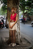 """Zhangzhengya, an independent clothing seller, age 24, poses for a portrait in Nanjing. Response to 'What does China mean to you?': 'To me the word China is like a mother. It provides for you. Doesn't ask you to give anything back. We are proud to have a """"mother"""" like this. Self-pride.'  Response to 'What is your role in China's future?': 'We should believe that we will grasp our role in the future. Work hard. Generously think of ways to support our country.'"""