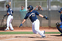 Milwaukee Brewers catcher Luis Avalo (97) follows through on his swing during an Instructional League game against the Los Angeles Dodgers at Maryvale Baseball Park on September 24, 2018 in Phoenix, Arizona. (Zachary Lucy/Four Seam Images)