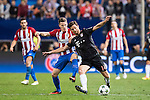 Xabi Alonso (R) of FC Bayern Munich fights for the ball with Kevin Gameiro of Atletico Madrid in action during their 2016-17 UEFA Champions League match between Atletico Madrid vs FC Bayern Munich at the Vicente Calderon Stadium on 28 September 2016 in Madrid, Spain. Photo by Diego Gonzalez Souto / Power Sport Images