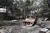 Pictured: A burned out house and car in Varibobi, Athens, Greece. Wednesday 04 August 2021<br /> Re: Forest fire in Varibobi, on the outskirts of Athens, Greece.