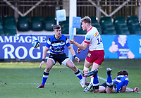 6th February 2021; Recreation Ground, Bath, Somerset, England; English Premiership Rugby, Bath versus Harlequins; Louis Lynagh of Harlequins passes under pressure from Tom de Glanville and Max Clark of Bath to set up the first try
