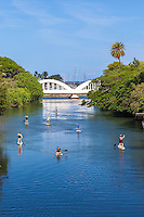 Standup paddleboarders on Anahulu Stream in Haleiwa, O'ahu
