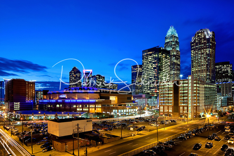 Close-in photography of the Charlotte NC skyline, taken at sunset (series of images shows sky changing colors as the sun falls below the horizon). Image includes the new Duke Energy Tower (shown far left).