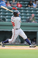 Catcher Anthony Nunez (58) of the Rome Braves bats in a game against the Greenville Drive on Thursday, July 31, 2014, at Fluor Field at the West End in Greenville, South Carolina. Rome won the rain-shortened game, 4-1. (Tom Priddy/Four Seam Images)