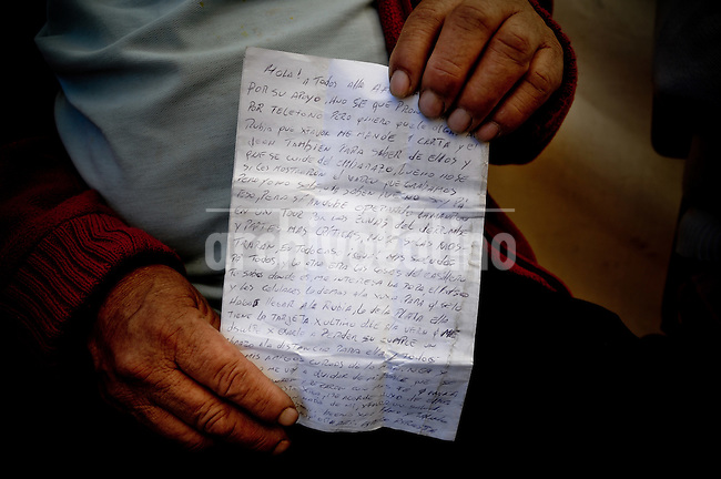 """Jessica Yañez (43) wife of Esteban Rojas (44) wich is trapped inside the mine.Hector Ticona (59) father of Ariel Ticona (29) He says """"thank you for your support I know that we will speak soon, tell to my wife that have to take care of the pragnacy, take care of the baby Relatives, friends and rescue team around the mine where 33 miners are trapped in a collapsed tunnel 700 meters under the ground in North of Chile"""