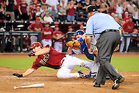Jul 20, 2008; Phoenix, AZ, USA; Arizona Diamondbacks base runner Stephen Drew is tagged out at home plate by Los Angeles Dodgers catcher Russell Martin after trying to score an in the park home run in the fourth inning at Chase Field. Mandatory Credit: Mark J. Rebilas-