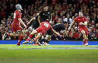 Pictured: Keven Mealamu of New Zealand (C) scores a try, Leigh Halfpenny of Wales (15) fails to stop him Saturday 22 November 2014<br />