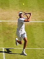 England, London, Juli 06, 2015, Tennis, Wimbledon, Ivo Karlovic (CRO) in action against Murray<br /> Photo: Tennisimages/Henk Koster