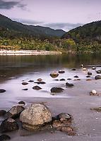 Pastel colours of alpen glow on beach with Kohaihai River near Karamea, Kahurangi National Park, Buller Region, West Coast, New Zealand